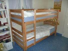 children's bedroom with bunk beds and door to large terrace