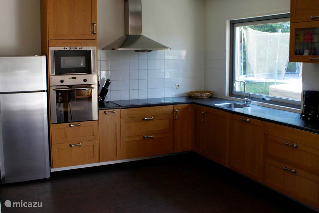 The modern fully equipped kitchen includes; refrigerator, 4 burner stove, oven, microwave and dishwasher. There is a washing machine.