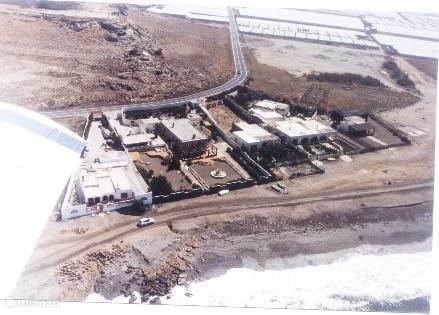Luchtfoto van het huis met omliggende grond