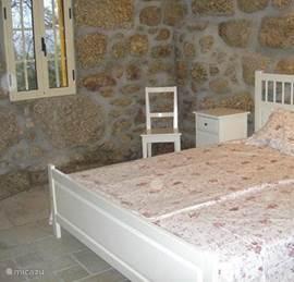 De eerste begane grond slaapkamer voor 2 volwassenen.