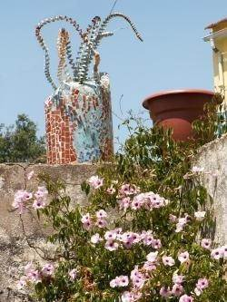 Mozaïekboom boven aan de trap naar de Termas