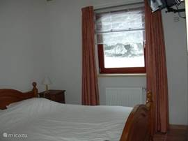 2 person bedroom downstairs with TV. with satellite receiver.