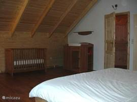 Spacious 2 double bedroom upstairs with TV. with satellite receiver, crib and dresser.