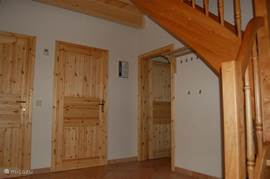 Spacious hall with coat rack.
