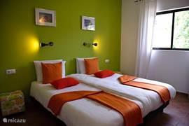 Deze suite heeft een apart slaapgedeelte en een apart leefgedeelte. Alle kamers met badkamer ensuite.