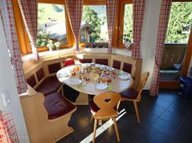 The sitting area in the bay window. From here you have a fantastic view over the village of Hinterglemm
