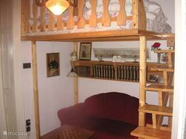 between room with a mezzanine with a double bed.