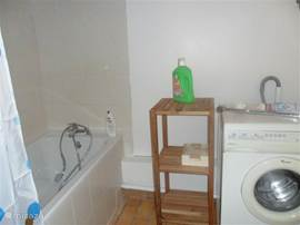 new bathroom with bath and washing machine