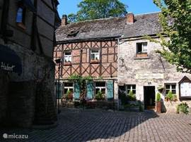 Romantic courtyard in Durbuy. Durbuy is not large, but very beautiful with narrow old streets, (timbered) houses, small shops, cozy restaurants and bars, terraces, etc.