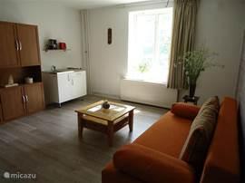Alle vijf appartementen hebben een eigen sfeervolle woonkamer.