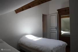 2e slaapkamer voorzien van toilet en douche.