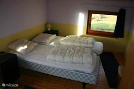 This is one of the three spacious bedrooms, small bedroom has a single bed and a foldaway bed.