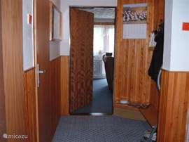 This is the hall with wardrobe and doors to the toilet, shower and kitchen