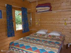 The second bedroom on the ground floor, heating and cozy