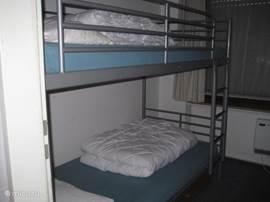 Slaapkamer met een stapelbed
