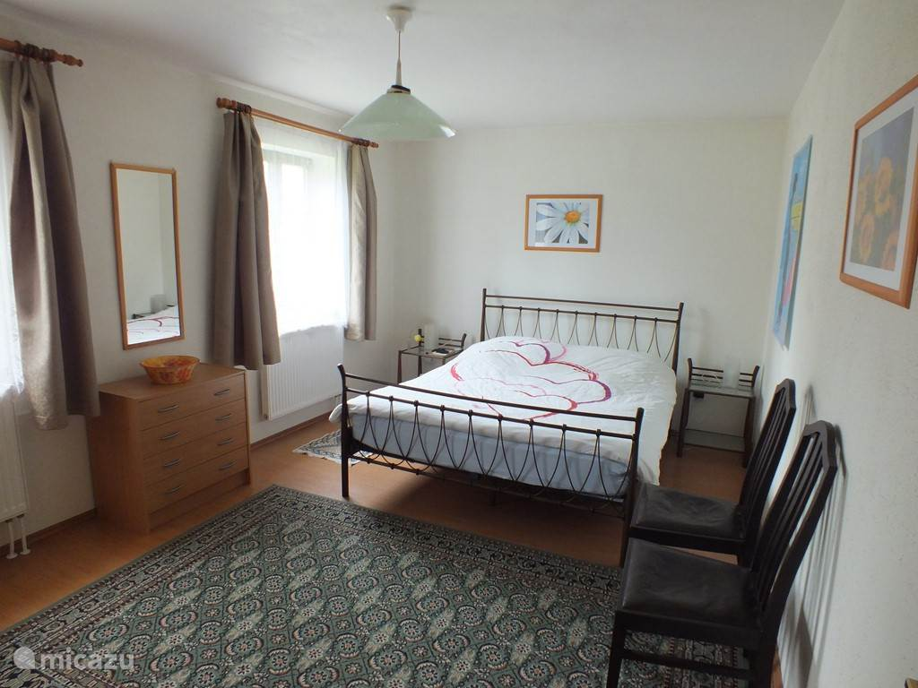 ground floor bedroom with two single beds