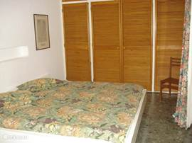 Bedroom with ample storage space