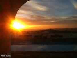 Zonsondergang vanaf terras Casa da Arvore Torta