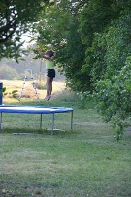 nice jump on the trampoline in the garden
