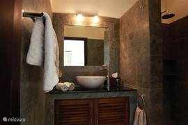 Tastefully decorated bathrooms of natural stone