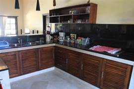 Fully equipped kitchen with refrigerator, gas stove, microwave, blender, toaster, sandwich maker, Nespresso coffee machine, coffee machine for filter coffee, water dispenser for hot and cold water