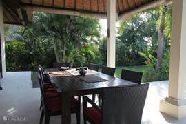 Covered terrace with large dining table