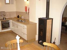 The kitchen has a cozy fireplace to snuggle `Heating. Fido` The coal-fired central heating ensures that heats the whole house down is delicious. No sense in burning? In the living room and kitchen has an infrared heater that efficient use of energy and more can be found in any other leaving an electric heater.