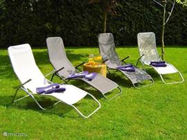 Loungers in the garden. The trees in the garden provide plenty of shade during the hotter days.