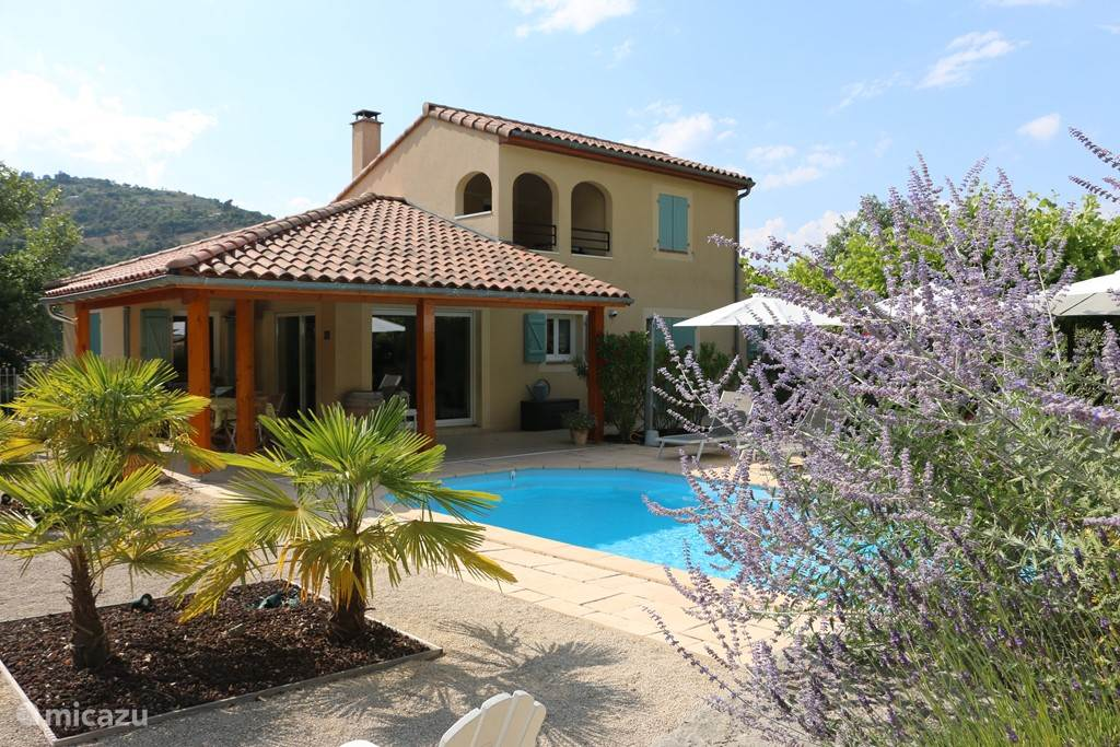 Luxury villa on the banks of the Ardeche. Large attractive garden with private heated pool. A lounge set under the plane trees and many trop cal plants.