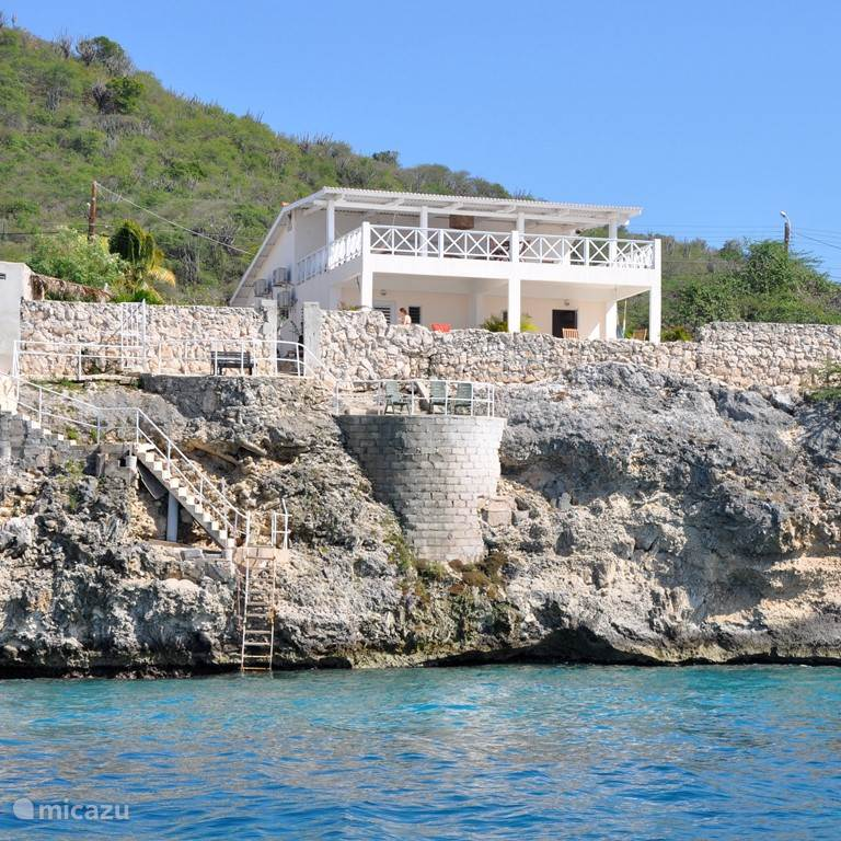 Dolphinhearthouse from the sea.  Above the terrace of the Main House. Below the two studios