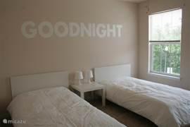 Goodnight-kamer voor met 2 éénpersoonsbedden.