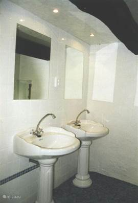 Bathroom, 2 sinks and showers, 1 toilet