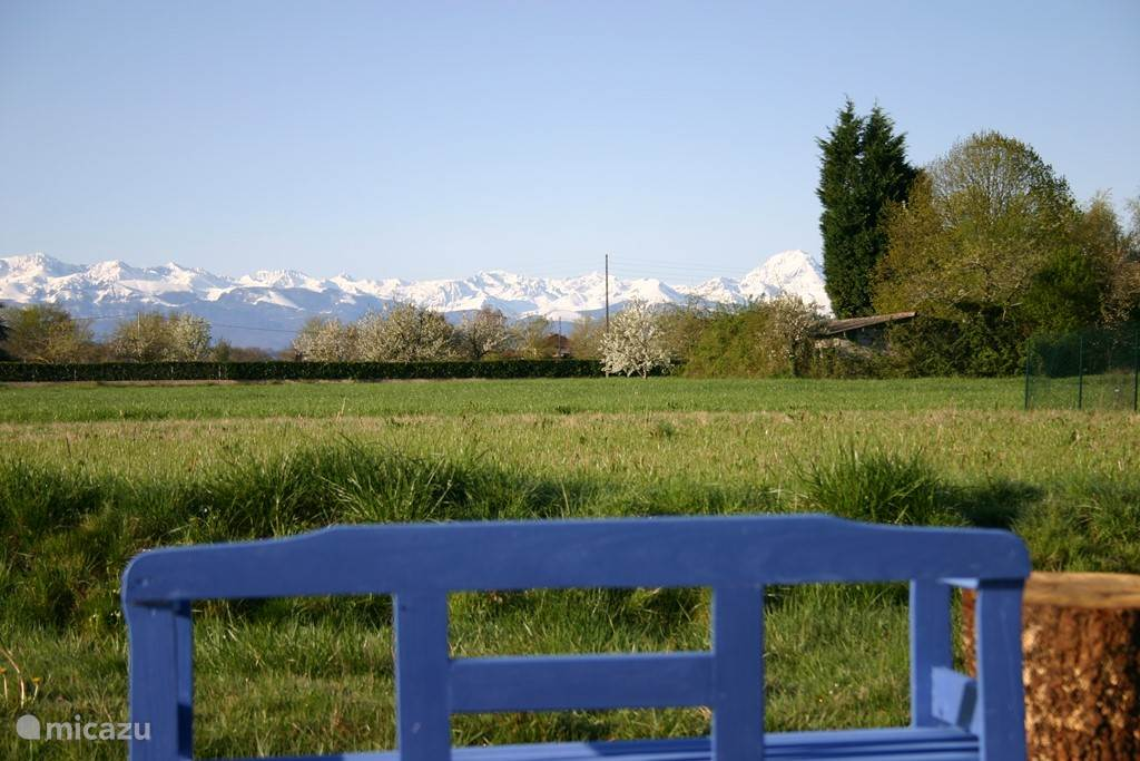 A bench in the hinterland overlooking the Pyrenees, wonderful views enjoy a cup of coffee early in the morning or late sunset with a glass of wine.