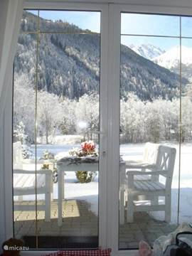 View from the living room over the snowy mountains