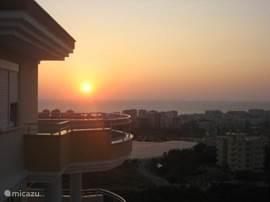 Elke avond zonsondergang vanaf balkon