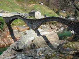 Valle Verzasca with azure blue water and green mountains an ancient Roman bridge where tough guys from Swiss diving!