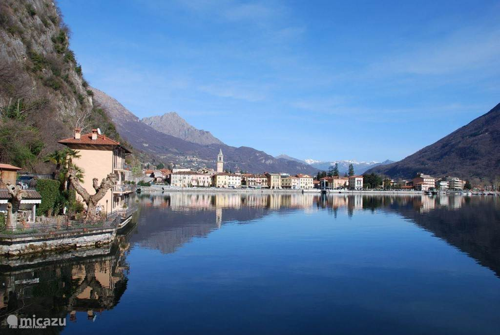 The pittoresque Italian village Porlezza with at the background the Alps of Lake Como