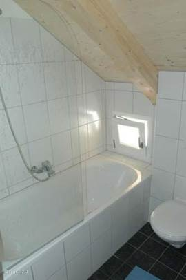 Upstairs bathroom with bath, sink and toilet
