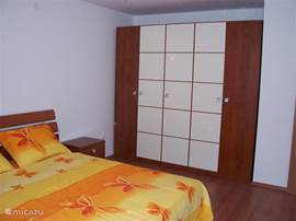 Spacious bedroom with large double bed.