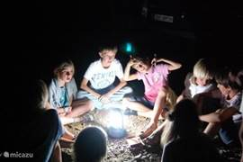 The children have fun with an exciting card game in the dark.
