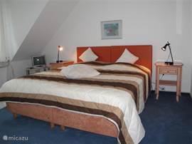 Room 1. This is a three person room. with new beds