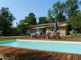 Our new swimming pool with a beautiful wooden terrace. The terrace has sun loungers. The pool is 8 by 4 meters deep and 120.