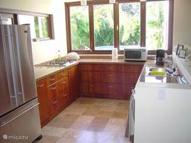 U shaped kitchen overlooking the pool. Always contact.