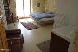 Guesthouse with private shower, toilet and door to the covered terrace.