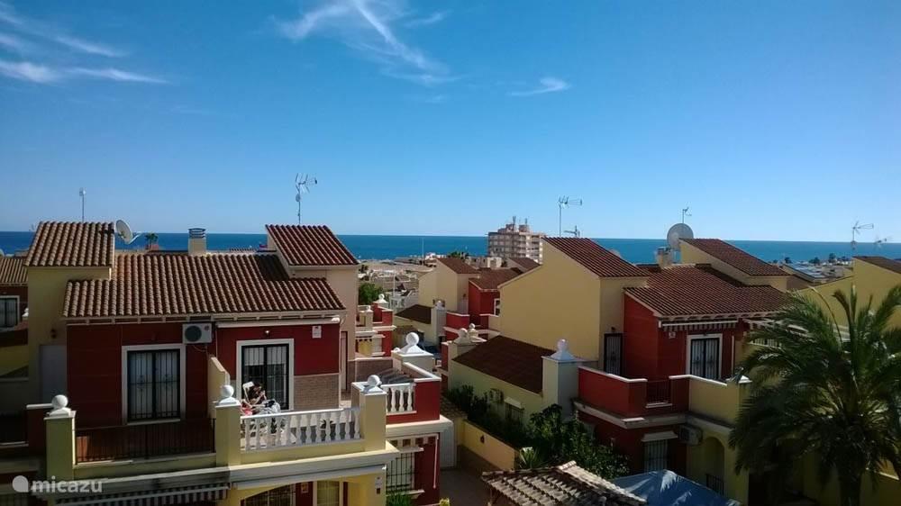 Het uitzicht vanaf het dakterras