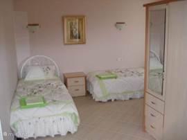 Tweepersoons slaapkamer voorzien van eigen badkamer