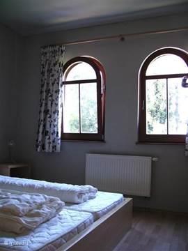 3e slaapkamer op bovenverdieping met 2-persoons bed.