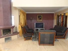 Tv Salon en openhaard