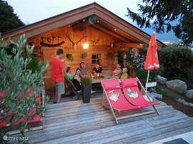 Sauna cabin with comfortable seat, also for spending a lovely summer evening.