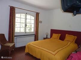 ground floor bedroom with TV